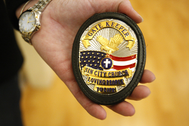 Jayne Post shows a Gate Keeper badge created for medical and security skilled volunteers at Sin City Church. (Erik Verduzco/Las Vegas Review-Journal)