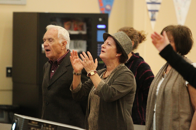 Leny Gasbarrino, left, and his wife Rita, sing along during Sunday services at Sin City Church, 50 N. Stephanie St., in Henderson. (Erik Verduzco/Las Vegas Review-Journal)