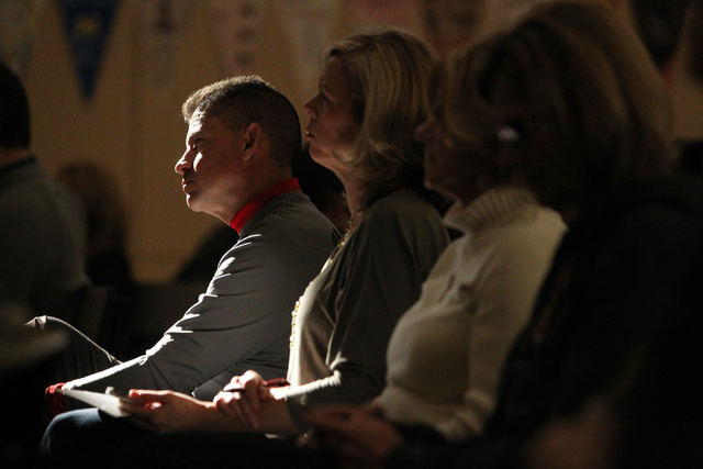 Michael Chinn, left, and his wife Wendy, listen during Sunday services at Sin City Church, 50 N. Stephanie St., in Henderson, Jan. 4, 2015. (Erik Verduzco/Las Vegas Review-Journal)