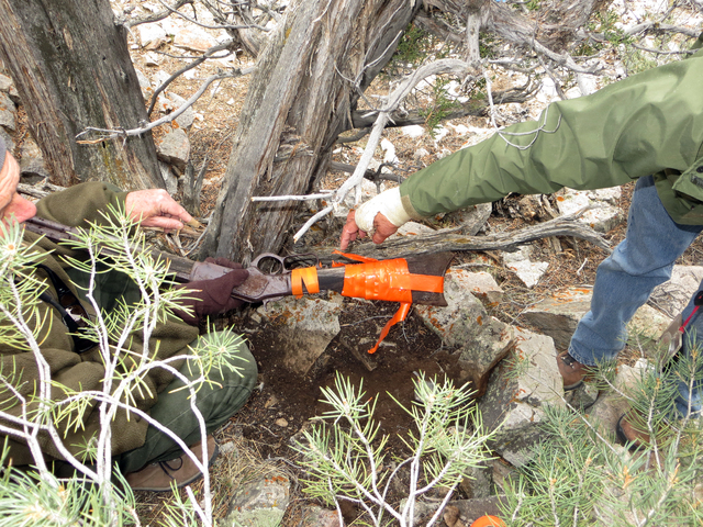 Staff members at Great Basin National Park examine a 132-year-old Winchester rifle found beneath a tree in a remote part of the park on Nov. 6. (Courtesy of the National Park Service)