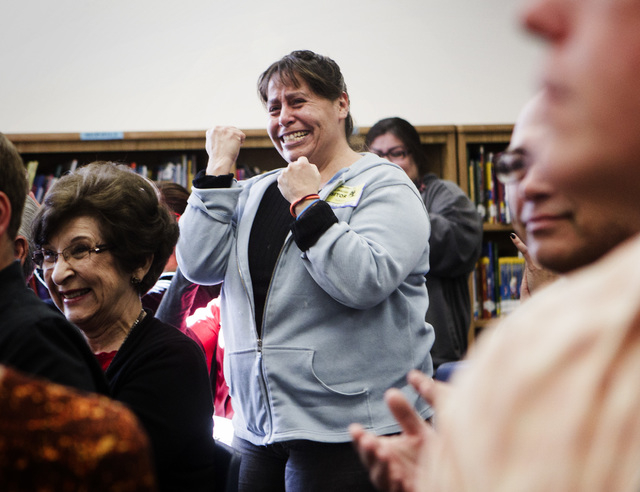 Alice Macis, celebrates after her daughter received a college scholarship from The Rogers Foundation Wednesday, January 21, 2015 at Reynaldo Martinez Elementary School, 350 East Judson Avenue, Nor ...