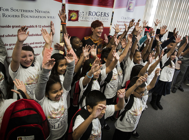 Beverly Rogers,center, chairman of the board for The Rogers Foundation stand  Wednesday, January 21, 2015 with students at Reynaldo Martinez Elementary School, 350 East Judson Avenue, North Las Ve ...
