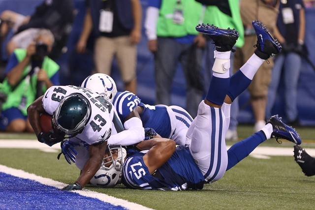 Philadelphia Eagles running back Darren Sproles (43) scores a touchdown as he breaks a tackle by Indianapolis Colts linebacker Josh McNary (57) at Lucas Oil Stadium, Sept. 15, 2014. (Brian Spurloc ...