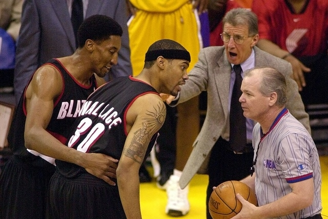 Trail Blazers assistant coach Tim Grgurich (upper left) joins in the fray as Portland Trail Blazers Rasheed Wallace is restrained by teammate Scottie Pippen (L) as Wallace argues a technical foul  ...