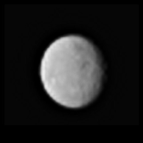 This processed image, taken Jan. 13, 2015, shows the dwarf planet Ceres as seen from the Dawn spacecraft. The image hints at craters on the surface of Ceres. Dawn's framing camera took this image  ...