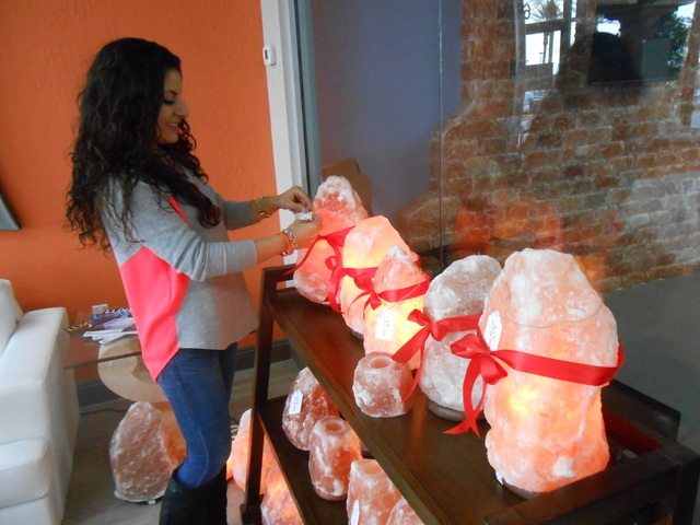 Ava Mucikyan arranges ribbons on ​salt rock lamps Dec. 17, 2014, at the Salt Room LV. The l​amps are said to permeate the air with negative ions for a sense of balance. (Jan Hogan/View)
