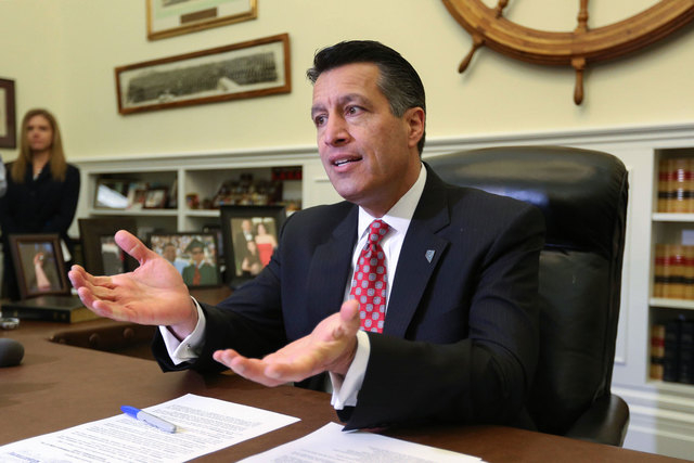 Gov. Brian Sandoval answers media questions following his inauguration at the Capitol in Carson City on Jan. 5, 2015. Sandoval is expected to seek a new business license fee based on gross receipt ...