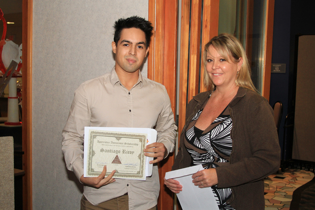 Scholarship winner Santiago Ricoy and Crystal Slaughter, SNWACA president