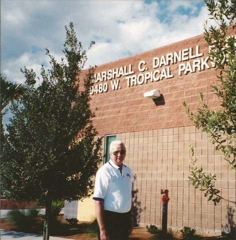 Marshall C. Darnell poses for a photo next to Marshall C. Darnell Elementary School, 9480 W. Tropical Parkway, which was named after the career educator who spent approximately 30 years working fo ...
