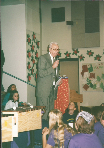 Marshall C. Darnell talks to students from Marshall C. Darnell Elementary School, 9480 W. Tropical Parkway, which was named after him for his lifelong dedication for education. (Special to View)