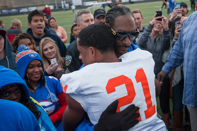 Bishop Gorman's Cordell Broadus (21) celebrates with his father Snoop Dogg after winning the NIAA Nevada State High School Division I Championship game against Reed on Saturday, Dec. 6, 2014 in Re ...