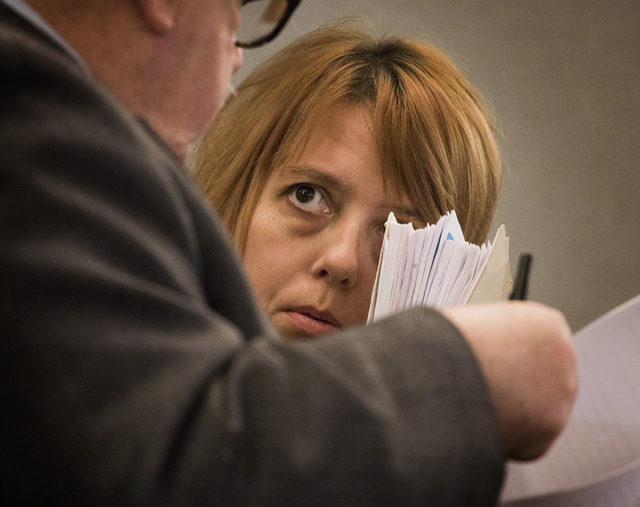 Terrie Sena,right, confers with defense attorney Tom Pitaro while appearing in Las Vegas Justice Court at the Regional Justice Center,200 Lewis Avenue, on Tuesday, Jan. 27, 2015.  Terrie Sena, her ...