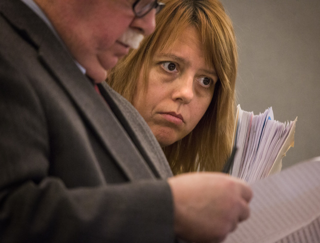 Terrie Sena,right, confers with defense attorney Tom Pitaro while appearsing in Las Vegas Justice Court at the Regional Justice Center, 200 Lewis Avenue, on Tuesday, Jan. 27, 2015.  Terrie Sena, h ...