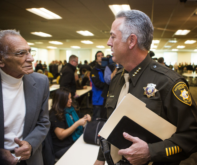 Newly elected sheriff Joe Lombardo,right, talks to his dad Joseph C. Lombardo during a  swearing  in ceremony at Las Vegas Metropolitan Police Department Headquarters, 400 S. Martin Luther King Bo ...