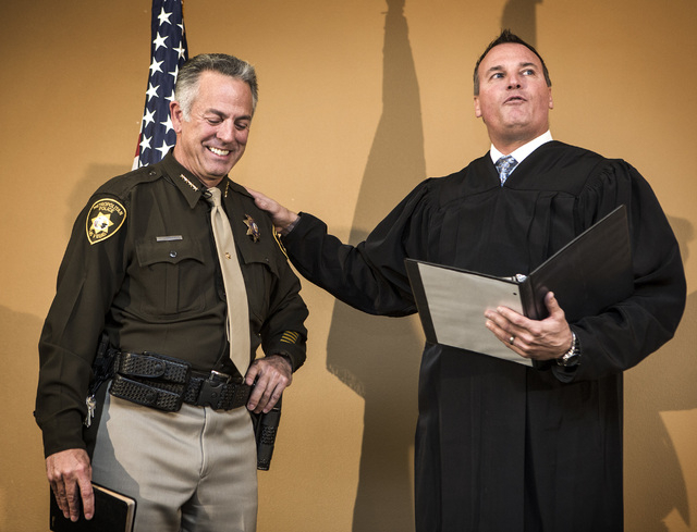 Judge William Kephart, right, swears in newly elected sheriff Joe Lombardo, at Las Vegas Metropolitan Police Department Headquarters, 400 S. Martin Luther King Boulevard, on Monday, Jan. 5, 2015.  ...