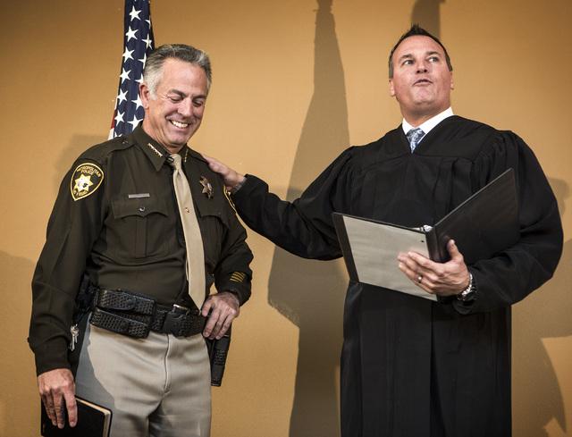 Judge William Kephart, right, swears in newly elected sheriff Joe Lombardo, at Las Vegas Metropolitan Police Department Headquarters, 400 S. Martin Luther King Boulevard, on Monday, Jan. 5, 2015.  ...