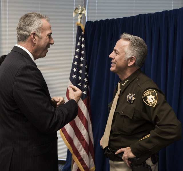 Clark County District attorney Steve Wolfson, left, talks to newly elected sheriff Joe Lombardo during a  swearing  in ceremony at Las Vegas Metropolitan Police Department Headquarters, 400 S. Mar ...