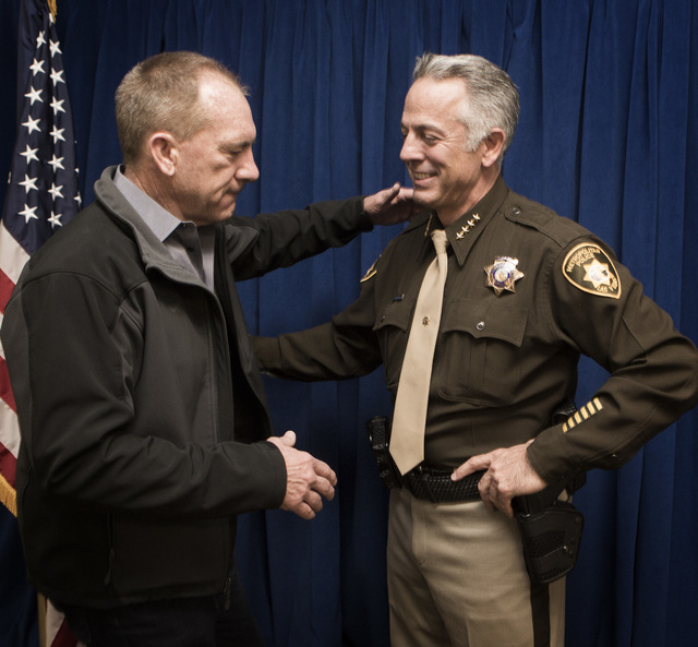 Former Clark County Sheriff Bill Young  left, congradulates newly elected sheriff Joe Lombardo during a  swearing  in ceremony at Las Vegas Metropolitan Police Department Headquarters, 400 S. Mart ...