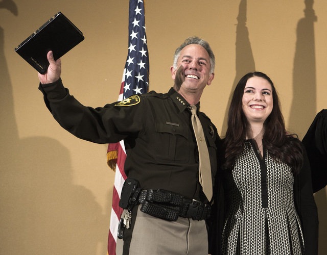 Newly elected sheriff Joe Lombardo,left, and his daughter Morgan during a  swearing  in ceremony at Las Vegas Metropolitan Police Department Headquarters, 400 S. Martin Luther King Boulevard, on M ...