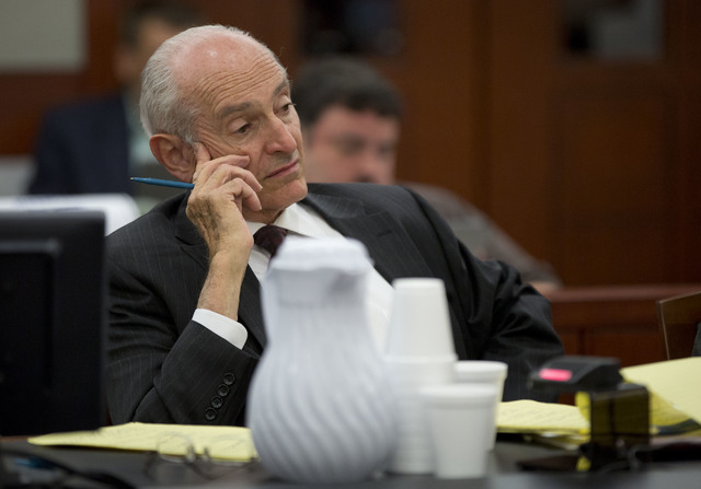Chief deputy Clark County district attorney H. Leon Simon listens to testimony by O.J. Simpson during an evidentiary hearing in Clark County District Court, Wednesday, May 15, 2013, in Las Vegas.  ...