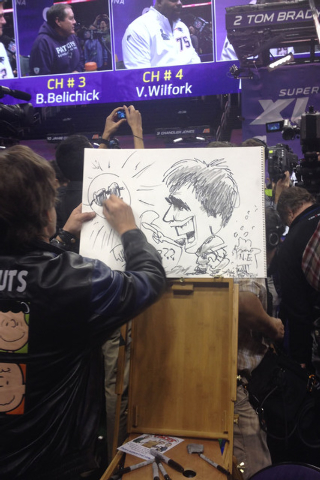 A caricature artist sketches participants in Bowl media day. (Ed Graney/Las Vegas Review-Journal)
