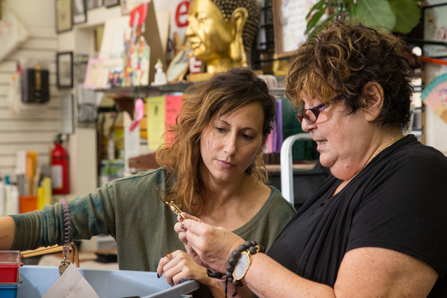 Jessica Poole, left, and her daughter Renee Poole sort through items for their shop. (Donavon Lockett/View)