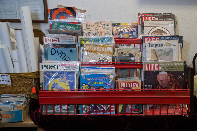 Collectable magazines are displayed in a rack at Not Just Antiques. (Donavon Lockett/View)