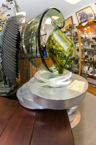 A glass sculpture is priced at $1,500 at Not Just Antiques. (Donavon Lockett/View)