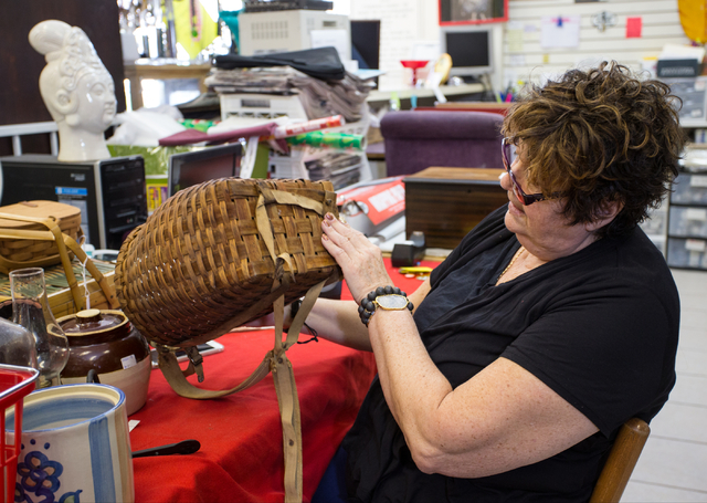 Renee Poole sorts through new items Jan. 12 at Not Just Antiques, 1422 Western Ave. Poole, an estate liquidator, owns the business with her daughter Jessica. (Donavon Lockett/View)