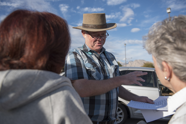 Las Vegas City Councilman Bob Beers, center, directs volunteers from left, Lisa Mayo and Denise Denning to the route where they'll be walking door to door gathering signatures for the initiative t ...