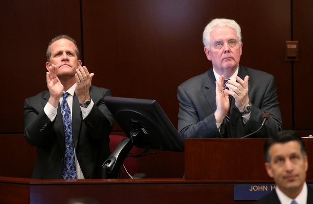 Lt. Gov. Mark Hutchison, left, and Assembly Speaker-elect John Hambrick, R-Las Vegas, acknowledge people in the crowd during Gov. Brian Sandoval's State of the State address at the Legislative Bui ...