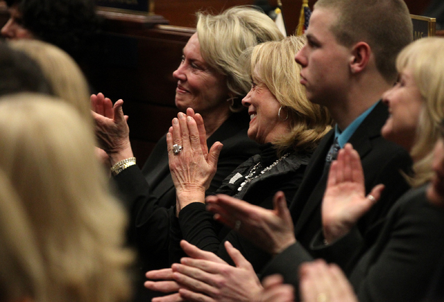 Dale Raggio, left, the widow of former Senator Bill Raggio and former first lady Dema Guinn react to Nevada Gov. Brian Sandoval's State of the State address at the Legislature in Carson City, Nev. ...