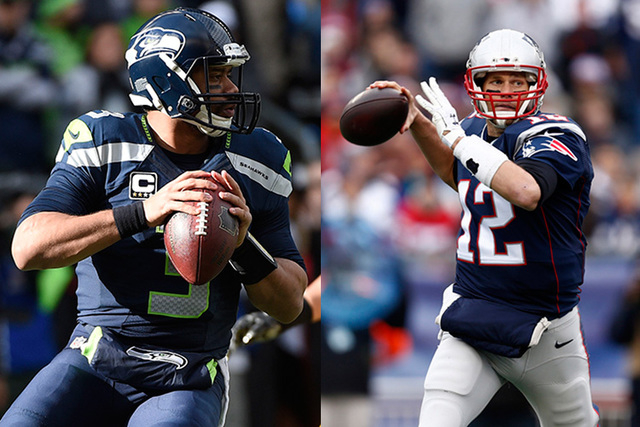 January 18, 2015; Seattle, WA, USA; Seattle Seahawks quarterback Russell Wilson (left) throws against the Green Bay Packers during the first quarter in the NFC Championship game at CenturyLink Fie ...
