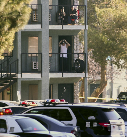 Residents on balconies watch as Las Vegas police respond to a situation with a suicidal man armed with a knife at an apartment complex at 3770 Swenson St. near Twain Avenue in Las Vegas on Thursda ...