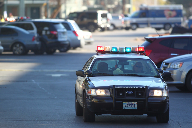 A Las Vegas police officer leaves the scene after a situation with a suicidal man armed with a knife is defused at an apartment complex at 3770 Swenson St. near Twain Avenue in Las Vegas on Thursd ...