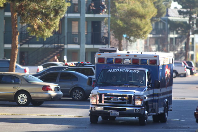 An ambulance leaves the scene after a situation with a suicidal man armed with a knife is defused at an apartment complex at 3770 Swenson St. near Twain Avenue in Las Vegas on Thursday, Jan. 8, 20 ...