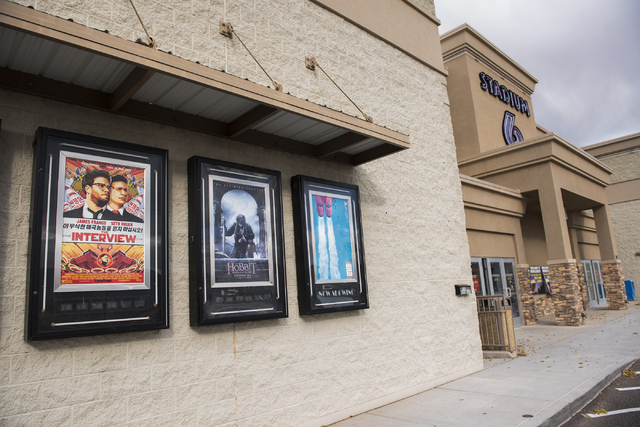 The movie poster of film The Interview is shown on the left, outside the Megaplex 6 theatres in Mesquite, Nev., during its release on Christmas day Thursday Dec. 25, 2014. (Martin S. Fuentes/Las V ...