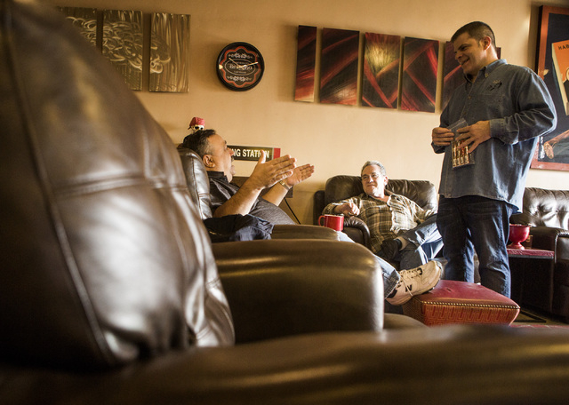 Michael Abdoulah, right, owner of  En Fuego Cigars & Lounge, 328 West Sahara Avenue, talks to costumers Joe Fallico, left, and Dave Moretti on Wednesday, Jan. 28, 2015. Gov. Brian Sandoval is prop ...