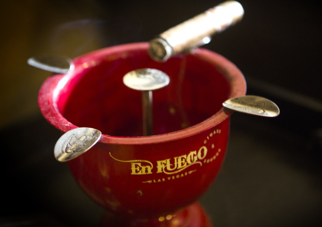 A cigar sits on an ashtray Wednesday, Jan. 28, 2015 at En Fuego Cigars & Lounge, 328 West Sahara Avenue. Gov. Brian Sandoval is proposing to raise taxes on tobacco.(Jeff Scheid/Las Vegas Review-Jo ...