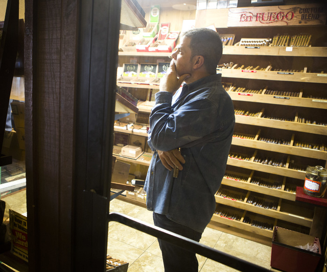 Michael Abdoulah, owner of  En Fuego Cigars & Lounge, 328 West Sahara Avenue, stands in a humidor on Wednesday, Jan. 28, 2015. Gov. Brian Sandoval is proposing to raise taxes on tobacco.(Jeff Sche ...