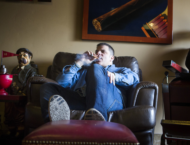 Michael Abdoulah, owner of  En Fuego Cigars & Lounge, 328 West Sahara Avenue, relaxes with a cigar on Wednesday, Jan. 28, 2015. Gov. Brian Sandoval is proposing to raise taxes on tobacco.(Jeff Sch ...