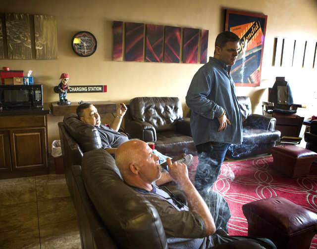 Michael Abdoulah, right, owner of  En Fuego Cigars & Lounge, 328 West Sahara Avenue, talks to costumers Joe Fallico, left, and James Berns on Wednesday, Jan. 28, 2015. Gov. Brian Sandoval is propo ...