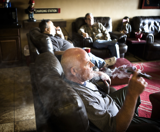 James Berns relaxes with a cigar Wednesday, January 28, 2015 at En Fuego Cigars & Lounge, 328 West Sahara Avenue. Gov. Brian Sandoval is proposing to raise taxes on tobacco.(Jeff Scheid/Las Vegas  ...