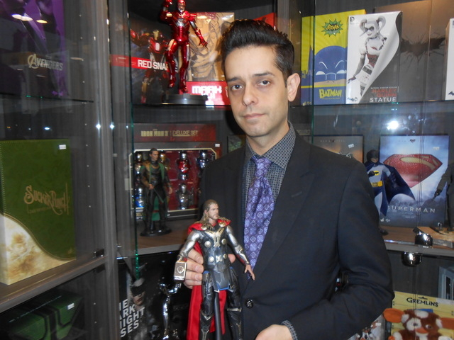 Justin Archbold, owner/operator of The Toy Box at Downtown Summerlin, holds a Thor action figure Dec. 3, 2014. The high-end piece has realistic details straight from the movie and is one of the co ...
