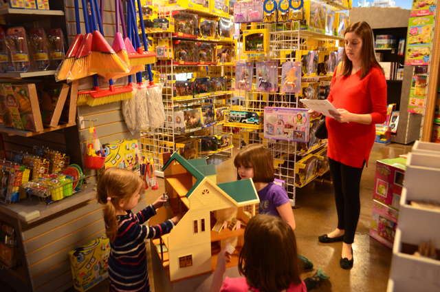 Children play with a doll house at The Doll House & Toy Store, 13802 N. Scottsdale Road in Scottsdale, Ariz., one of the oldest family-owned toy stores in the country. (Ginger Meurer/Las Vegas Rev ...
