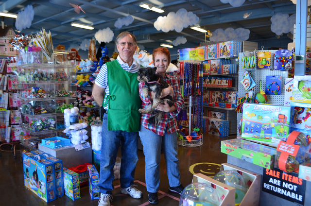Sam and Sari Powazek, photographed with their resident rescue puppy Sydney, own The Doll House & Toy Store, 13802 N. Scottsdale Road in Scottsdale, Ariz., one of the oldest family-owned toy stores ...