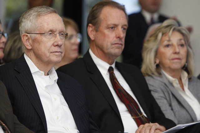 U.S. Sen. Harry Reid, D-Nev., from left, North Las Vegas Mayor John Lee, and U.S. Rep. Dina Titus, D-Nev., listen during an event to celebrate the passage of legislation by Congress that designate ...