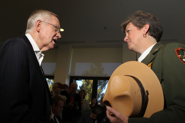 U.S. Sen. Harry Reid, D-Nev., left, speaks with Chris Lehnertz, Pacific West Regional Director of the National Park Service, during an event to celebrate the passage of legislation by Congress tha ...