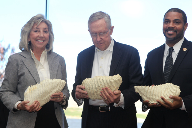 U.S. Rep. Dina Titus, D-Nev., from left, U.S. Sen. Harry Reid, D-Nev., and U.S. Rep. Steven Horsford, D-Nev., hold casts of a Columbian mammoth tooth they received as gifts   during an event to ce ...