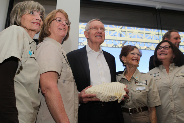 U.S. Sen. Harry Reid, D-Nev., center, is photographed holding a cast of a Columbian mammoth tooth he received as a gift with members of Protectors of Tule Springs, from left, Sandy Croteau, Jill D ...
